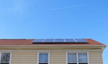 Solar panels on roof with asphalt shingles