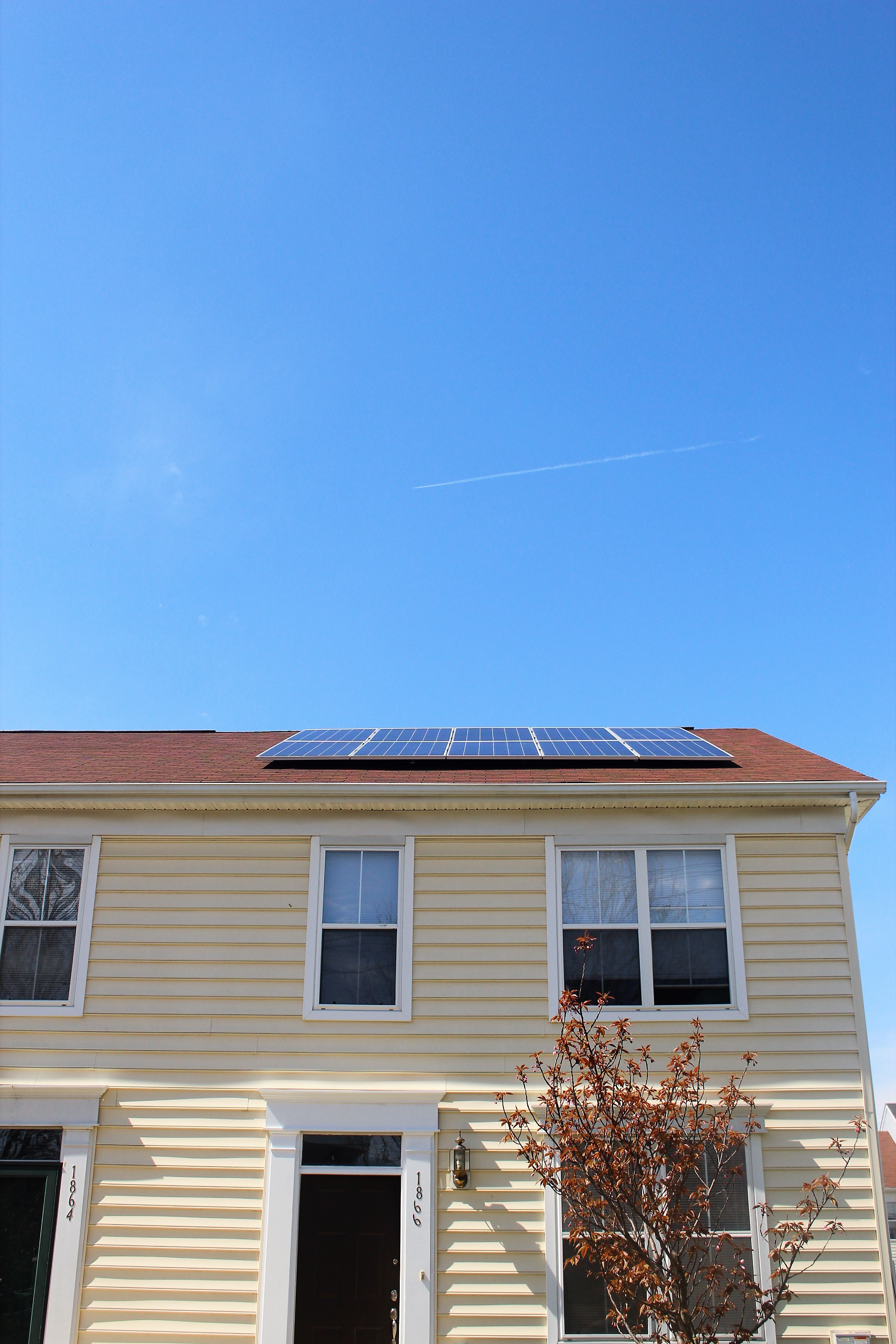 Solar panels on roof with asphalt shingles
